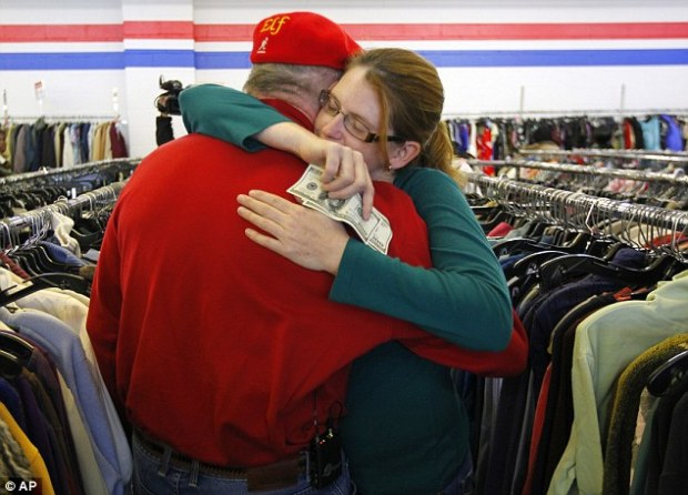 Making a difference: Staten Island resident Janice Kennedy hugs her Secret Santa after getting a $100 dollar bill from the wealthy philanthropist from Kansas City, Missouri inside a Salvation Army store