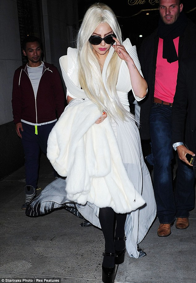 Ice queen: Gaga is currently rocking peroxide hair and matched it to her white structural dress and fur coat