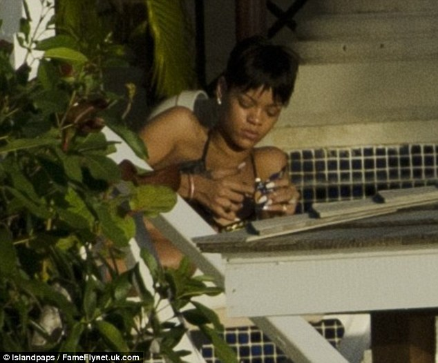 Still peckish: Rihanna pulled a face of upset as her meal seemed to leave her unsatisfied