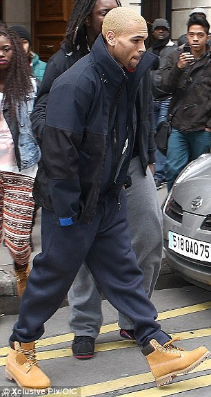 Just ten days ago... Chris was seen leaving Rihanna's hotel on December 10 in Paris
