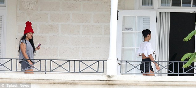 Luxury: Rihanna made her way off the balcony and into the villa as she friend followed behind