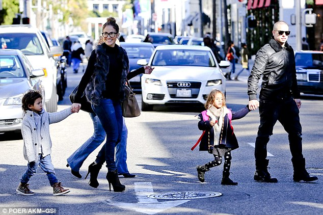 Traffic stoppers: Cars in Beverly Hills must have screeched to a stop when Jennifer and her entourage marched by