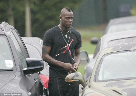 Leaving the scene: Balotelli left in his camouflage car