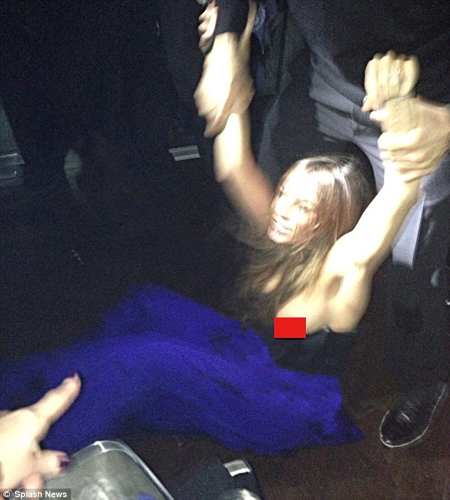 Oops! Sofia Vergara's ample breast slipped out of her plunging dress in the midst of a scuffle during a New Year's Eve bash in Miami