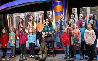 Moving tribute: The children, aged six to nine, appeared with singer Ingrid Michaelson on GMA this morning