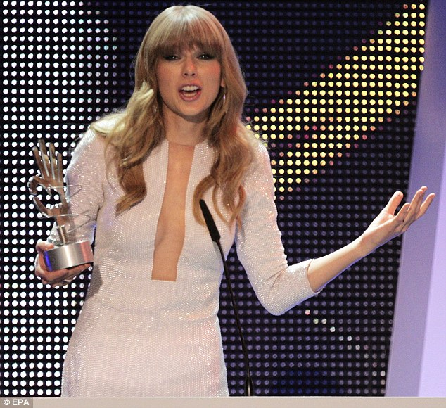 Cleavage: Taylor wore the show stopper to collect her International Artist Award but not to perform