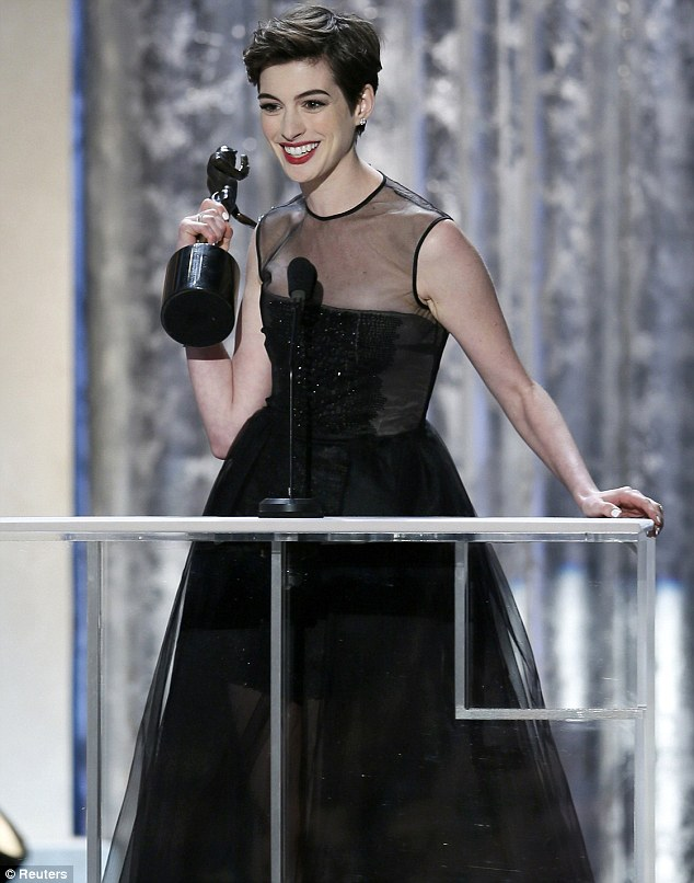 Double triumph: Anne Hathaway gave an emotional speech after winning the award for Best Supporting Actress at the SAG awards