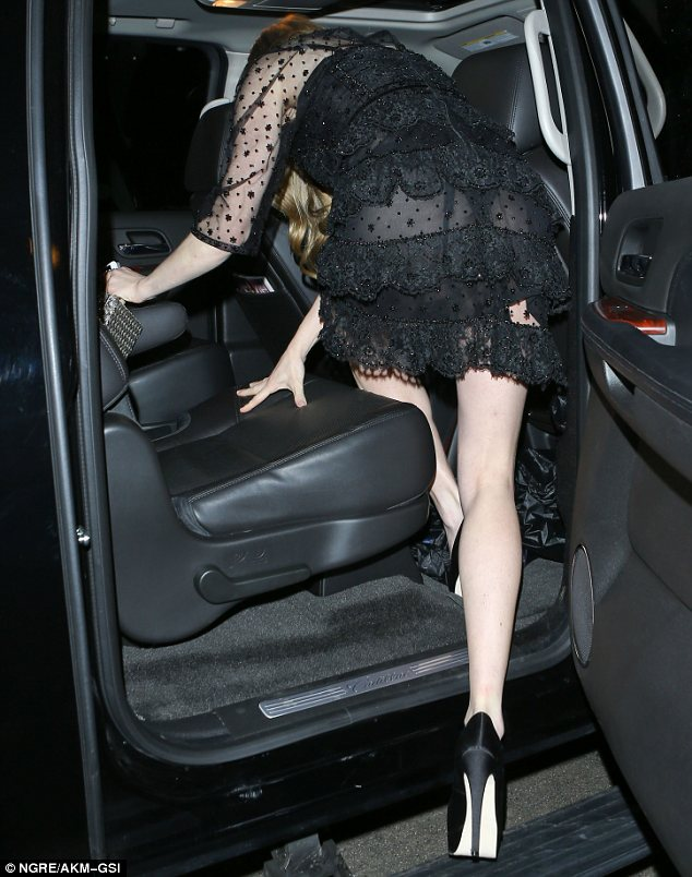 Overexposure: As she was photographed stepping into her car Amanda's underwear was clear for all to see