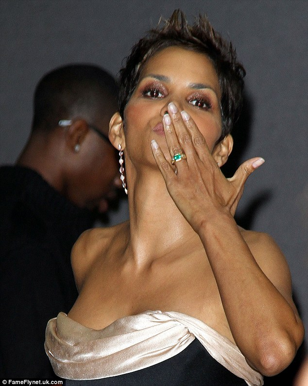 Kiss kiss: The actress blew kisses at the crowds as she made her way along the red carpet