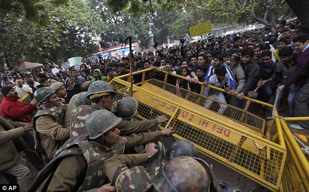 Anger: The savage assault caused outrage throughout India. Protestors are pictured trying to break through a police cordon during a demonstration in New Delh