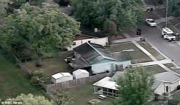 Bizarre: An aerial view of the home shows no sign of the sinkhole which claimed the man's life