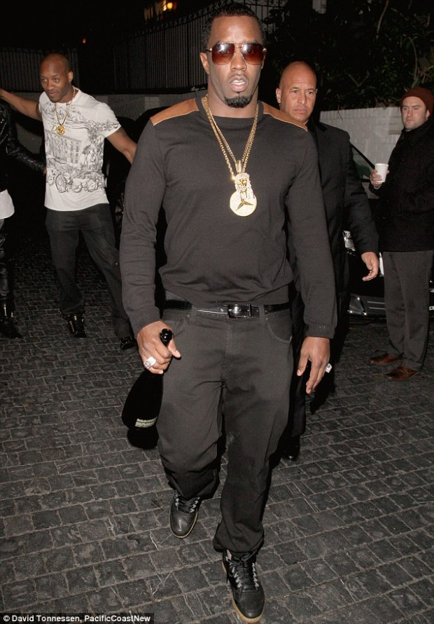 Naughty boy: Diddy risked getting a small fine when he carried an open bottle of champagne in Hollywood on Saturday