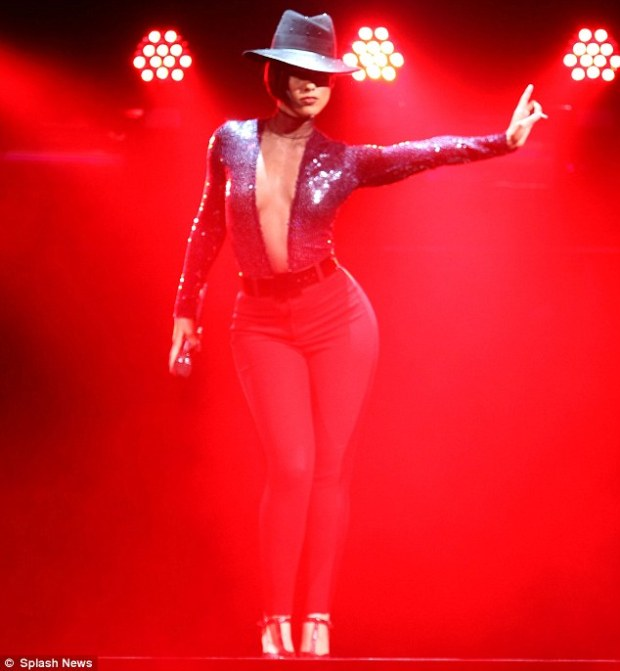 On fire! Alicia Keys wowed in a plunging sequin leotard as she performed at the Los Angeles Staples Centre as part of her Set The World On Fire Tour on Tuesday night