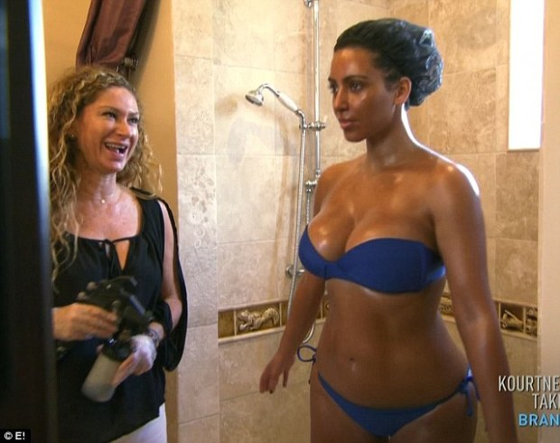 A tan is the best medicine: Kim Kardashian shows off her amazing figure as she tries to help her sister Kourtney be more confident in the latest episode of Kourtney And Kim Take Miami
