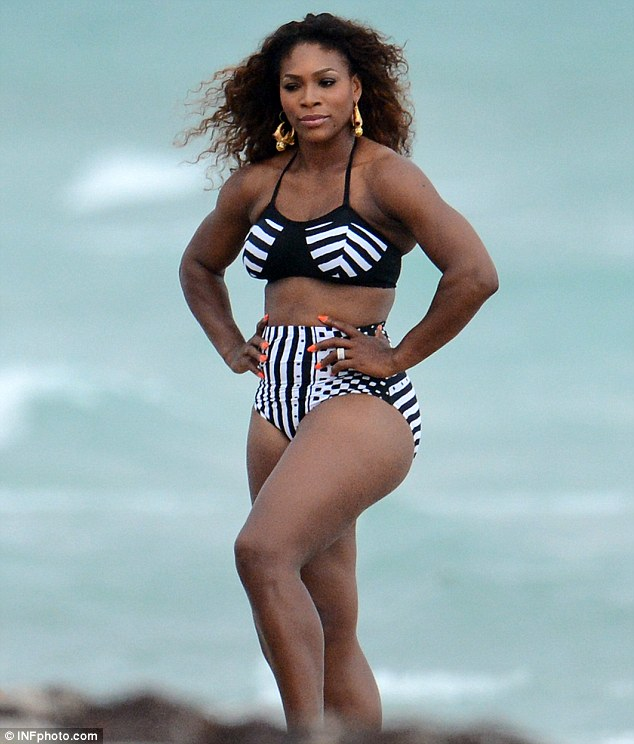 Strong: The 31-year-old showed off her athletic physique as she posed up a storm on the beach