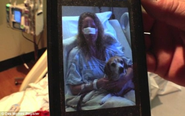 Visitor: Their pet, who was not badly injured in the attack, visited his owners in hospital, pictured