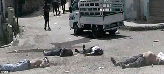 Massacred: This image provided by The Syrian Revolution against Bashar Assad reportedly shows dead bodies at Bayda village, where people were allegedly killed by regime forces