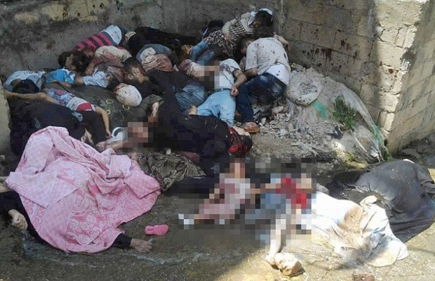 Slaughter: Innocent men, women and children - their bodies pixilated because the wounds were so gruesome - lie in a street in Banyias. It was released by Edlib News Network, ENN