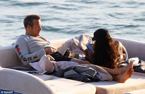 That's not Naomi! Vladimir Doronin was seen on his yacht in Miami on Tuesday with a woman who looked like the supermodel 