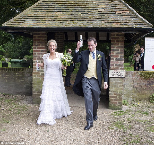 Shouldn't that be champagne? Verity Evetts and her husband were seen clutching Smirnoff Ice alcopops as they left the church