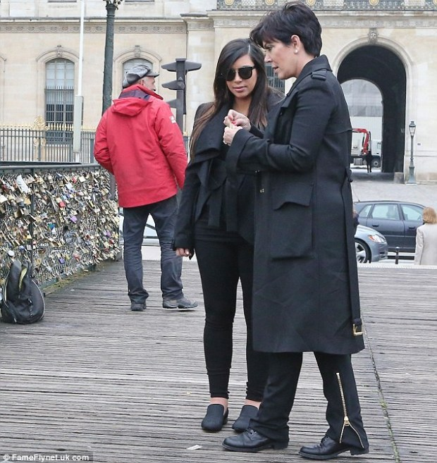Together forever! Kim Kardashian and Kris Jenner put their names on a lock at the romantic Pont l'Archeveche bridge in Paris on Tuesday