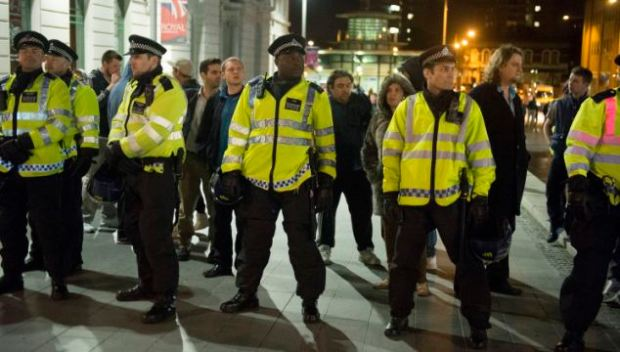 Police formed a cordon around the area as members of the group waved flags and chanted 'no surrender to the Muslim scum'