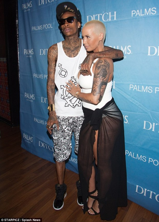 Happy couple: Wiz and Amber started dating in early 2011