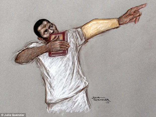 In court: Raising his arm into a Usain Bolt pose, Michael Adebolajo kisses a copy of the Koran with his eyes closed