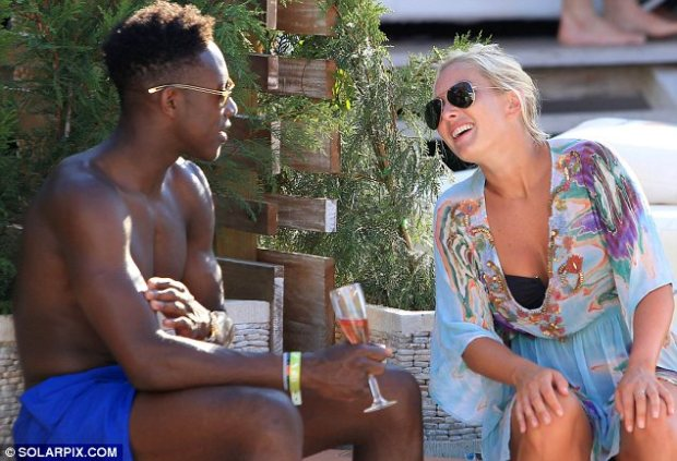 Laughter's a good sign: The 22-year-old centre-forward seemed to be using his charm on the woman, who was seen giggling at him