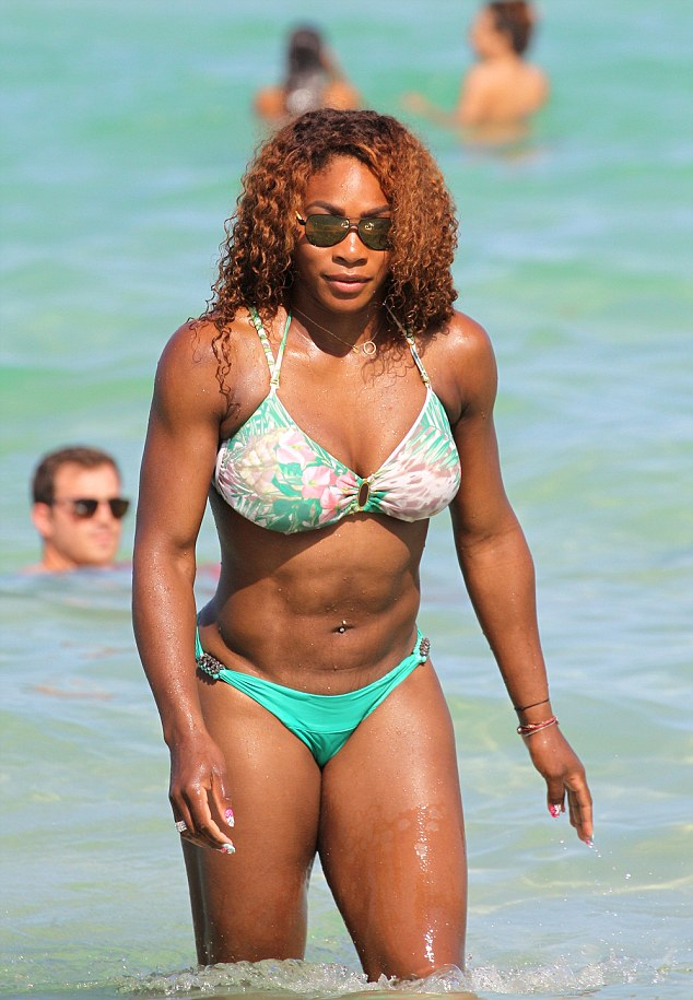 Body beautiful: A stunning Serena Williams emerges from the warm waters of Miami Beach in Florida on Saturday