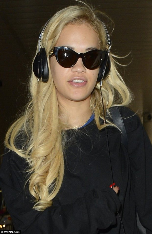 Cat's eyes: The singer wore feline shaped glasses home from seeing her boyfriend