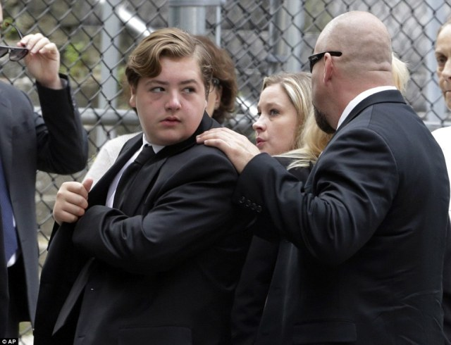 Traumatic: Michael Gandolfini, left, son of James Gandolfini, arrives for the funeral service of his father, whom he found dead during their Italy vacation last week