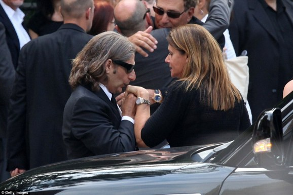Kiss goodbye: Michael Imperioli, who played Tony Soprano's nephew, Tony Soprano's nephew Christopher Moltisanti, kisses the hand of former co-star Lorraine Bracco, who played Dr. Jennifer Melfi