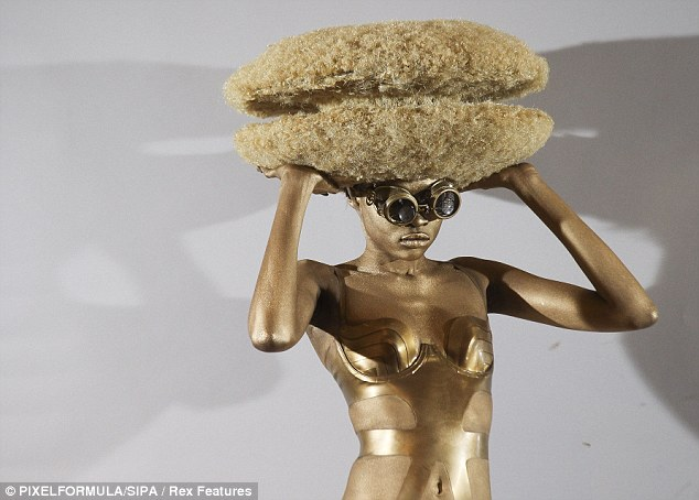 Bizarre: An Afro hair hamburger hat was styled with a gold bikini and a pair of retro binoculars