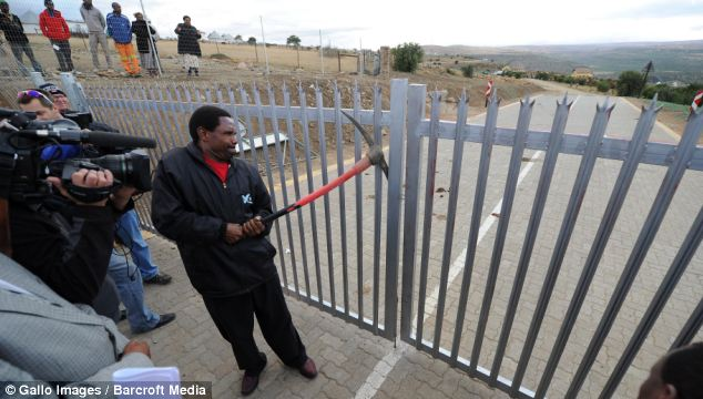 Bailiffs break down gates to the home of Nelson Mandela's grandson Mandla