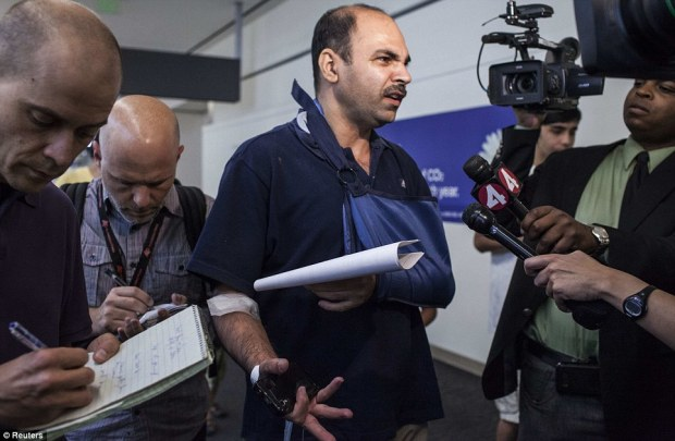 First-hand account: Veddpal Singh, a passenger from the crashed Asiana Airlines who suffered a fractured collarbone in the crash and had his arm in a sling, said that he heard a loud bang, and it was all over