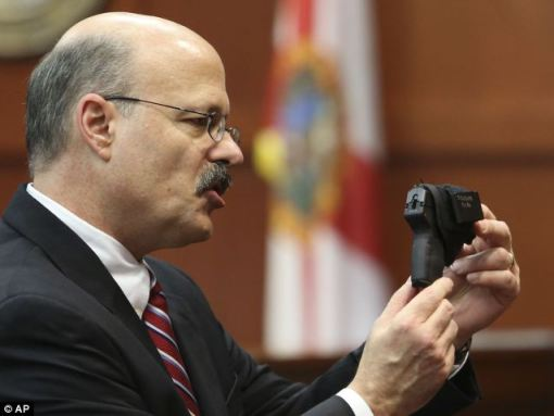Assistant state attorney Bernie de la Rionda showed the jury George Zimmerman's gun during his closing argument on July 11. Zimmerman defended himself with the weapon, killing Trayvon Martin