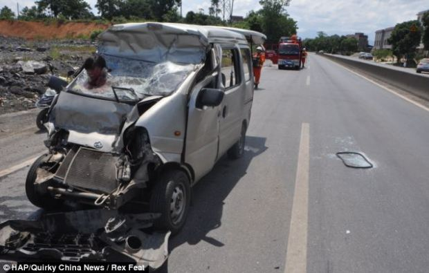 Horrific: The woman wasn't wearing a seat belt when the car crashed in southern China