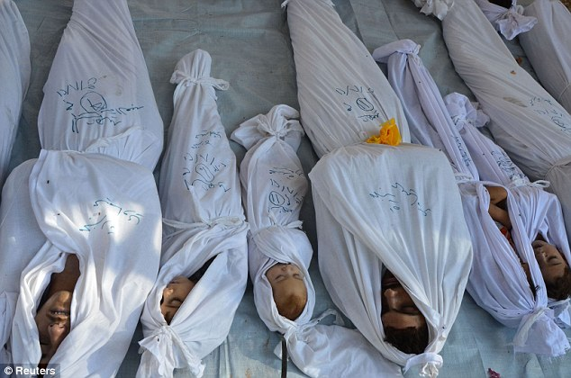 Bodies of people, including children, activists say were killed by nerve gas