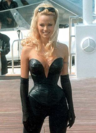 Pamela Anderson on the dock in front of the Carlton Hotel in Cannes