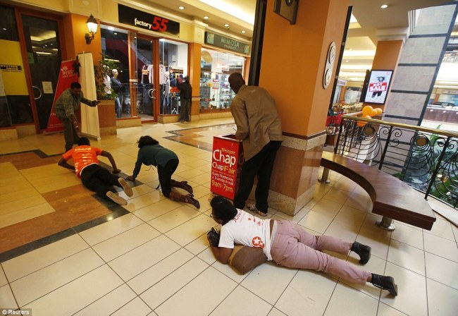 ScrambleScramble: People crawl on their stomachs to safety as security forces keep a lookout at the Nairobi mall on Saturday : People rush for safety away from gunfire between police and armed attackers