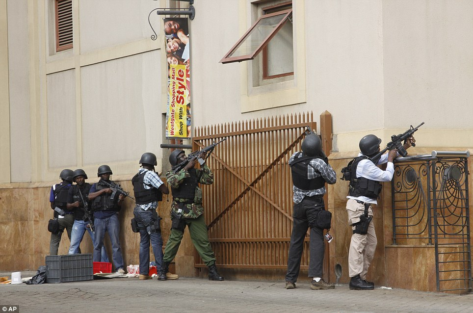 Special forces: The army and elite squads have now been drafted in to help police flush out the gunmen