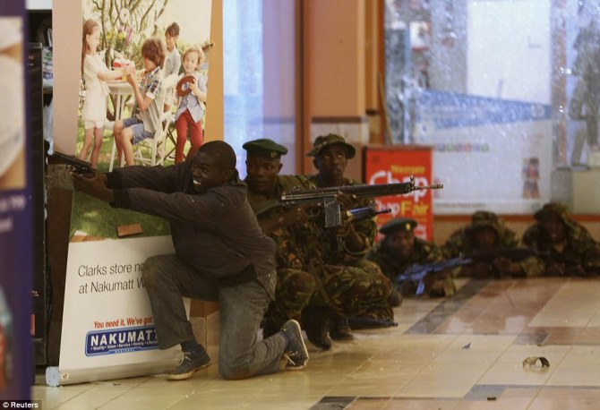 Shootout: Soldiers and armed police fire at the suspected terrorists as they try to wrest back control of the shopping centre
