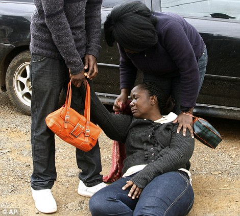 Relatives help a woman at the Nairobi City Mortuary after she identified the body of a victim of the Saturday attack at a mall.