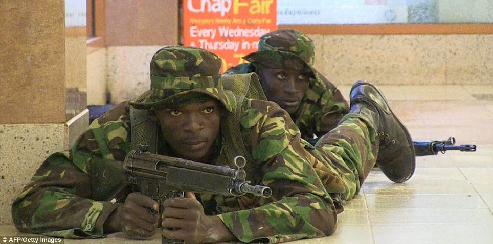 Armed response: Kenyan troops with machine guns take position in the mall