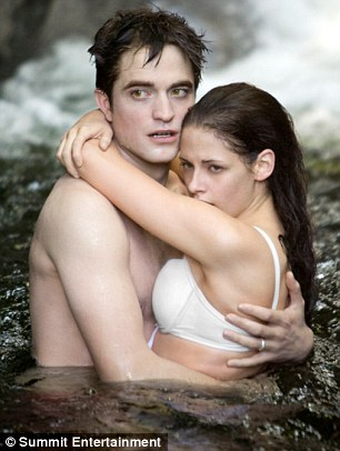 Back in the lake: Robert Pattinson and Stewart as Twilight's Edward and Bella shot a sexy lake scene in Breaking Dawn Part One