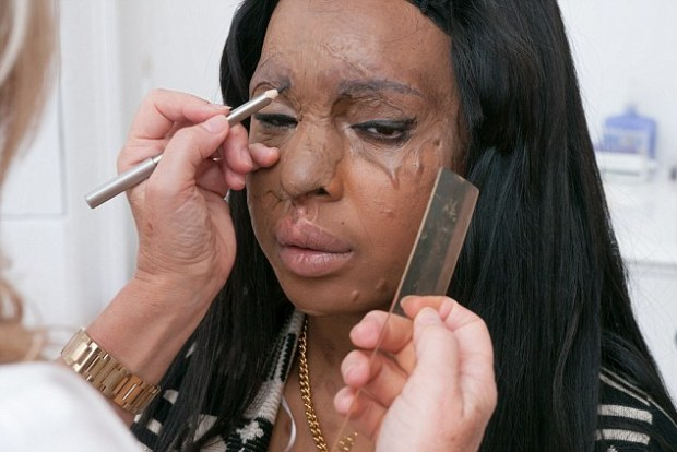 Delicate technique: Semi-permanent make-up expert Debra Robson pencils in the brow before using the tattoo needle to ensure the shape is right