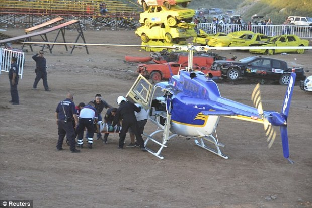 Medical attention: An injured spectator being airlifted out of the monster truck show yesterday