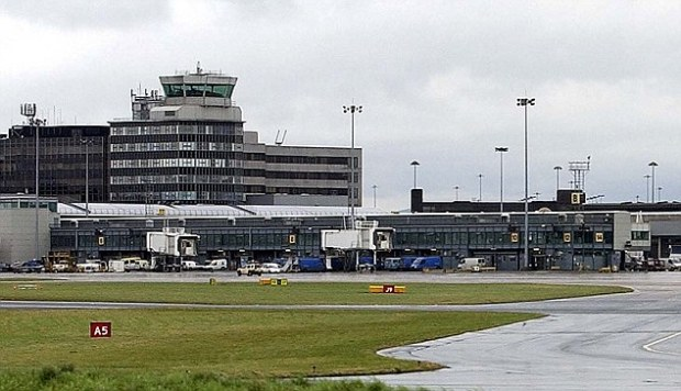 Incident: The passenger even urinated on the outer wall of Manchester Airport's terminal building (pictured) before he was arrested