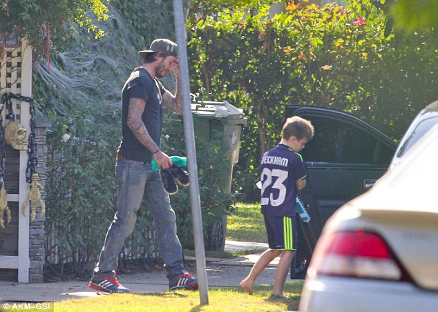 No Shoes Cruz David Beckham Carries His Youngest Son39s